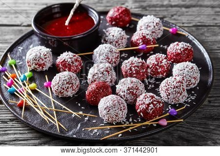Low-calorie Dessert: Berry Bliss Balls With Desiccated Coconut Mixed With Peanut Butter And Fresh Mi
