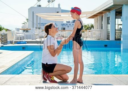 Family, Sport, Swimming, Health, Lifestyle Concept. Talking Mother And Child Daughter, Outdoor Swimm