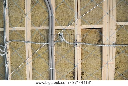 House Renovation: New Isolated Electric Wiring, Power Cables In Pvc Conduit On The Glass Wool Insula