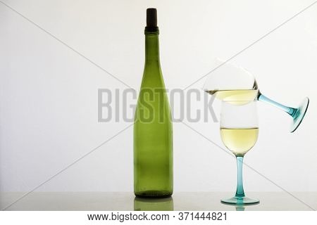 White Wine And Green Glass Bottle