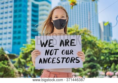 Woman Holds A Poster With An Inscription - We Are Not Our Ancestors
