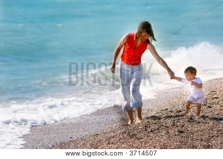 Mother And Son On Pebble Beach