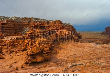 USA. Scenic Utah state park Goblin Valley. Picturesque hoodoos - huge remains of red-brown sandstone. The concept of active, ecological and photo tourism