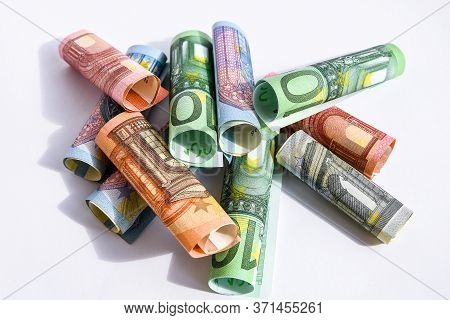 Rolled Up Euro Bills, Euro Banknotes Rolled Up On A White Background Several Hundred Euros On White