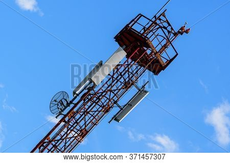 Telecommunications Antennas On The Telecommunications Tower With Clear Blue Sky In The Background