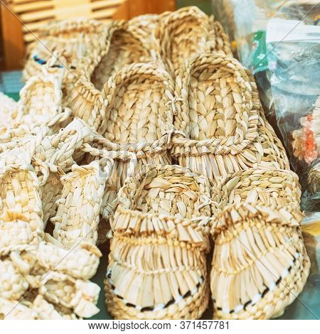 Souvenir Bast Shoes Woven From Bast. Old Traditional Russian Shoes