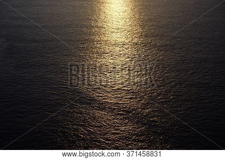 Marvelous Bright Yellow Sunlight Reflected In Calm Endless Ocean At Sunset Closeup