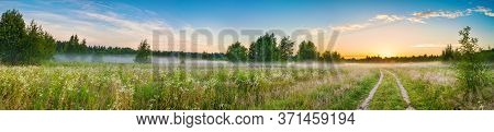 Amazing Panorama Summer Rural Landscape With Sunrise, Fog And Road. Scenery Spring Panoramic View
