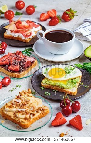 Breakfast Different Toasts With Berries, Cheese, Egg And Fruit, Light Background. Breakfast Table Co
