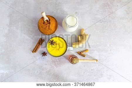 Flat Lay With Turmeric Latte And Ingredients - Milk, Ginger, Cinnamon, Honey. Ayurveda Treatment. Im