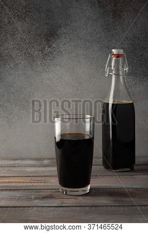 Dark Brown Bottle With A Bugle Plug Of Homemade Kvass And Glass. Wonderful Healthy Refreshing Drink