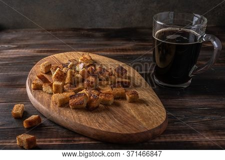 Homemade Tradishional Russian Kvass In Cup And Rusk On Cutting Board On Wooden Background. Wonderful