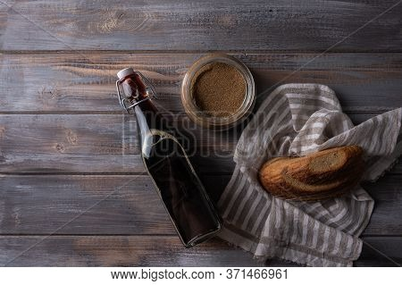 Top View Homemade Tradishional Russian Kvass In Glass Bottle With Leaven And Bread. Wonderful Health