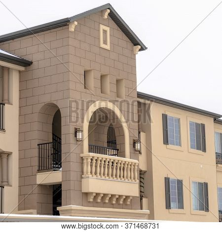 Square Crop Apartment With Snowy Front Gable Roof And Balustrade On The Arched Balcony