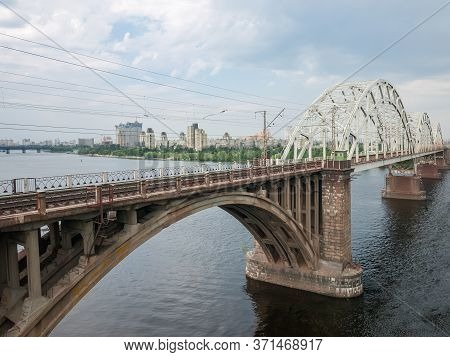Railroad Arch Bridge Built Of Stone, Concrete And Steel Over The River, Fragment. Darnytskyi Railroa
