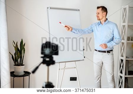Business Video Blogging, Vlogs About Finance, Sales. Young Attractive Guy In Smart Casual Wear Stand