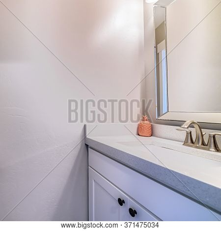 Square Bathroom Interior With View Of Sink Cabinets Wall Mirror Lights And Toilet