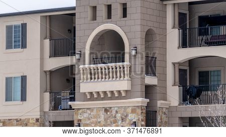 Panorama Frame Beautiful Apartment With Front Gable Roof And Arched Balcony Viewed In Winter