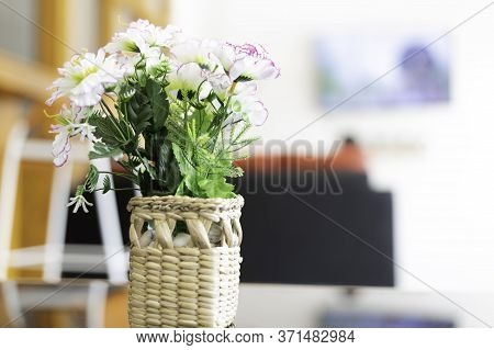 Artificial Flowers Are In A Basket Made Of Wickerwork, Used As A Beautiful Interior Decoration Of Th