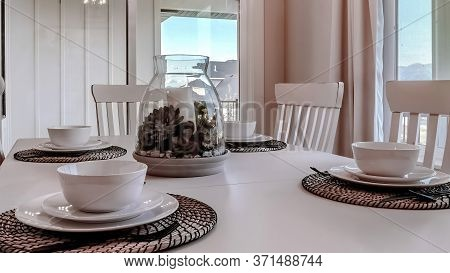 Panorama Dining Table With Chairs And Tableware Arranged Around A Decorative Centerpiece