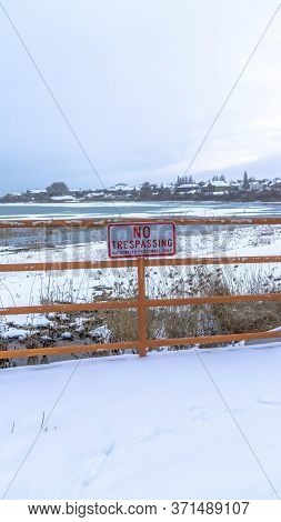 Vertical Frame Scenic Utah Lake In Winter With No Trespassing Sign A Fence In The Foreground