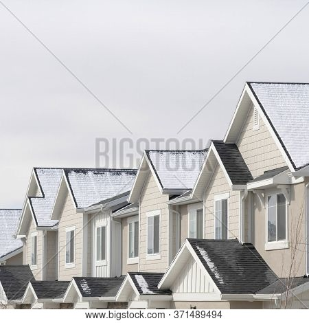 Square Frame Townhouses With Snowy Gable Roofs In South Jordan Utah On A Cloudy Winter Day