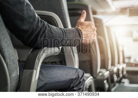 Public Transportation Passenger Showing His Thumb Up. Caucasian Men Seating Inside Intercity Coach B