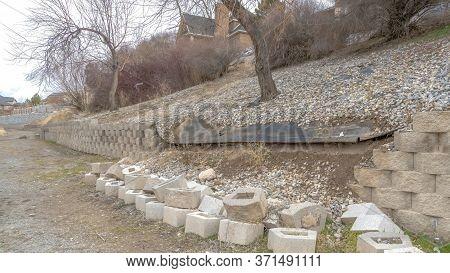 Panorama Neighborhood Scenery With View Of Collapsed Retaining Wall Made Of Stone Blocks