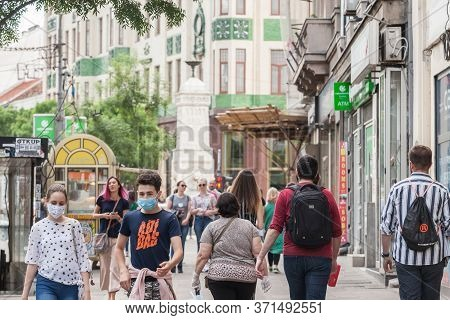 Belgrade, Serbia - May 9, 2020: Young People, A Young Man And A Young Girl, Friends, Walking Wearing