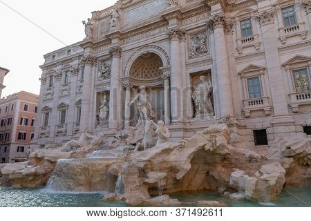 Panoramic View Of Trevi Fountain In The Trevi District In Rome, Italy. It Designed By Italian Archit
