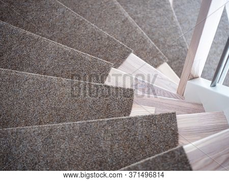 Partially Carpeted Wooden Stairs In A House