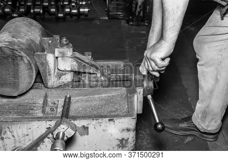 Hands Of The Master Make Repairs In The Machine Shop.