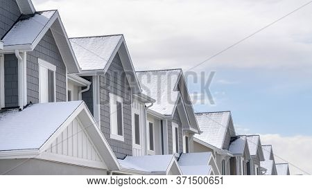 Panorama Crop Facade Of Snowy Townhouses In South Jordan Utah Against Cloudy Sky In Winter