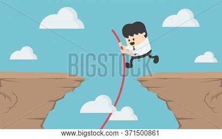 Young Business Man Who Jumps Over A Steep Cliff