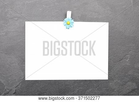 Colorful And Crisp Image Of Chit And Wooden Peg On Slate Board