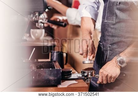 Closeup Asian Barista Tamping The Portafilter And Preparing Cup Of Coffee, Espresso With Latte Or Ca