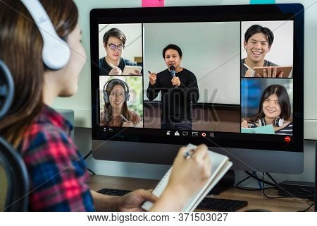 Rear View Of Asian Businesswoman Working And Online Meeting Via Video Conference With Colleague And