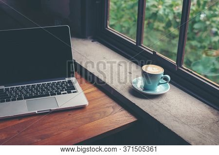 Work From Home And Stay At Home. Closeup Cup Hot Coffee Working With Laptop For Connection Online In