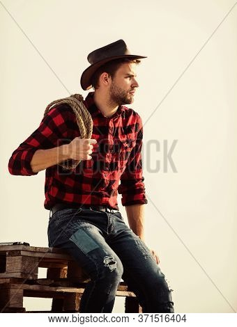 Any Way Possible. Cowboy With Lasso Rope. Western. Western Cowboy Portrait. Man Checkered Shirt On R
