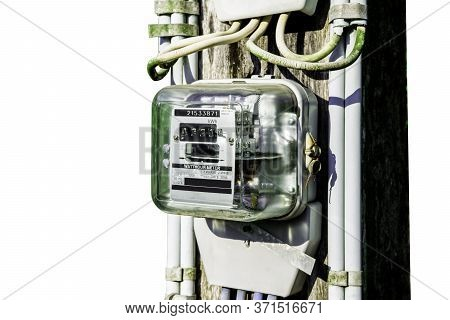 Electricity Meter Reading With Green Leaves Background, Meter Measuring Instrument, Watt-hour Meter