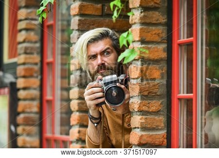 He Is Spy. Professional Photographer Use Vintage Camera. Bearded Man Hipster Take Photo. Photo Shoot