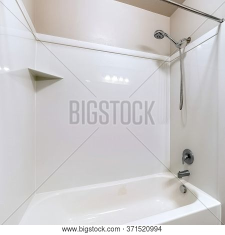 Square Bathroom Interior With Built In Bathtub Stainless Steel Shower Head And Faucet