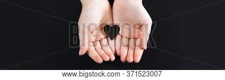 Hands Holding Black Paper Heart On Dark Background. Support Of Usa Movement Black Lives Matter. Peop
