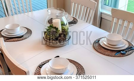 Panorama Dinner Table Setting With Tableware On Placemats Arranged Around A Centerpiece