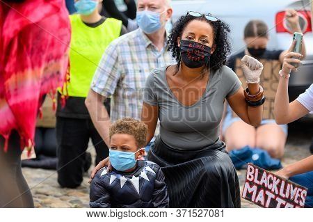 Richmond, North Yorkshire, Uk - June 14, 2020: A Woman Wears A Black Lives Matter Ppe Face Mask And