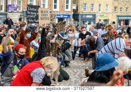 Richmond, North Yorkshire, Uk - June 14, 2020: Protesters Wear Ppe Face Masks And Hold Homemade Anti