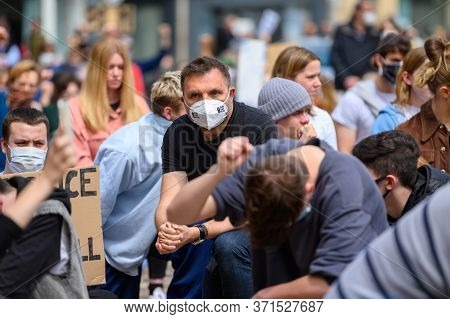 Richmond, North Yorkshire, Uk - June 14, 2020: A Caucasian Protester Wears A Ppe Face Mask While Sil