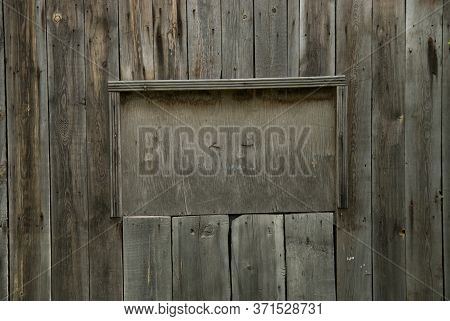Wooden Old Grey Background With A Niche For The Inscription. Advertising Space