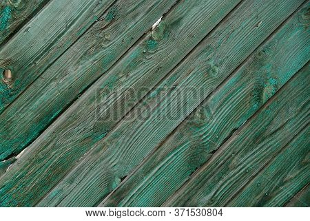 Background Of Old Painted Wooden Planks Laid Out Diagonally. Advertising Space