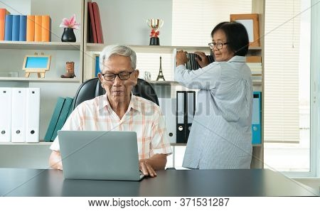 Happy Senior Asian Couple Using A Laptop At Home For Find New Tourist Attractions Together. Happy Re